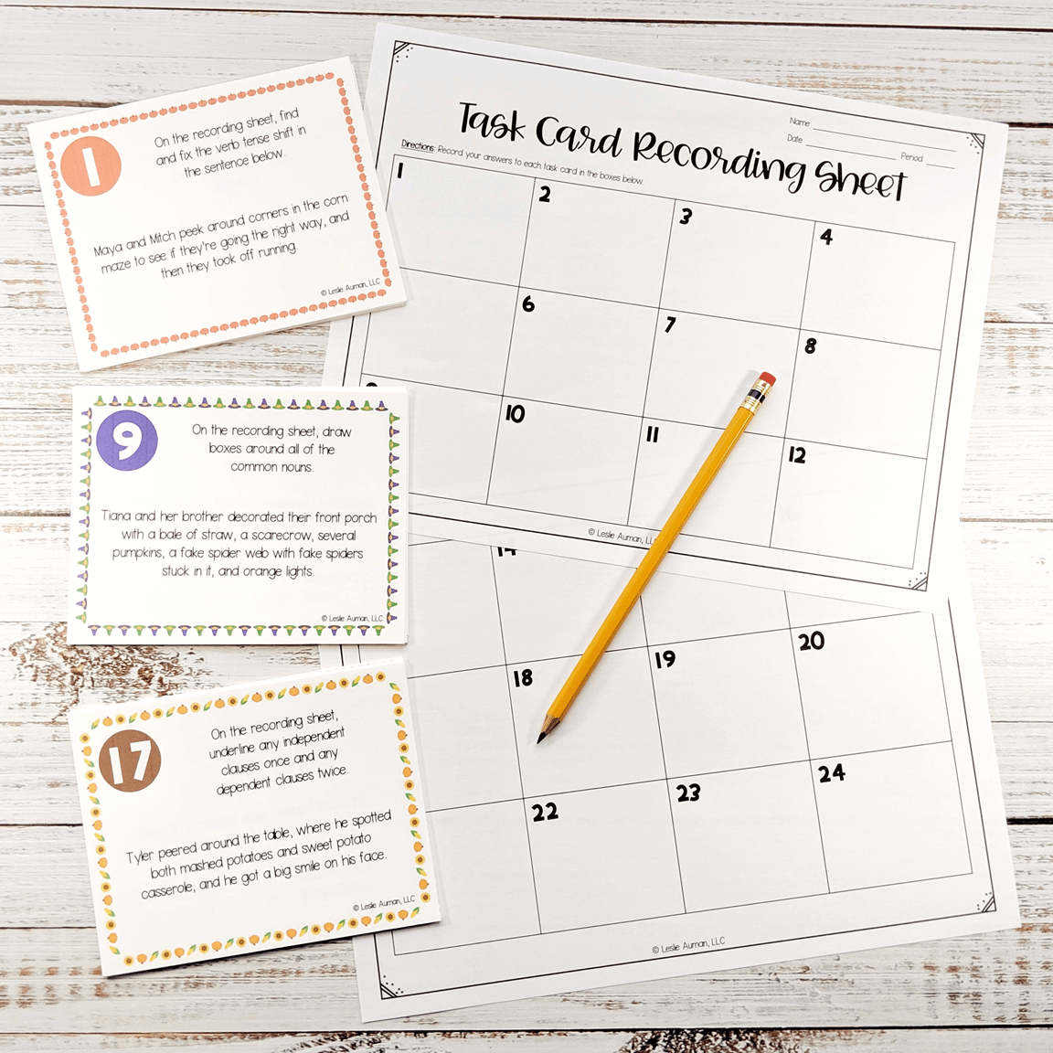 This is a photograph of a free set of fall grammar task cards, along with a recording sheet for answers and a pencil.